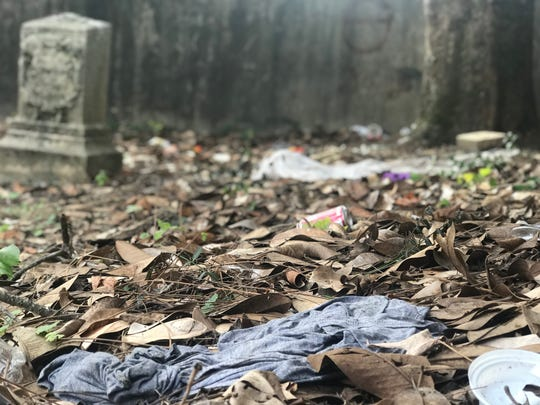 Old Gray Cemetery director Ruthie Kuhlman said the city's new homeless day camp has fanned out the city's homeless population and, as a result, she has seen increased desecration at the cemetery.