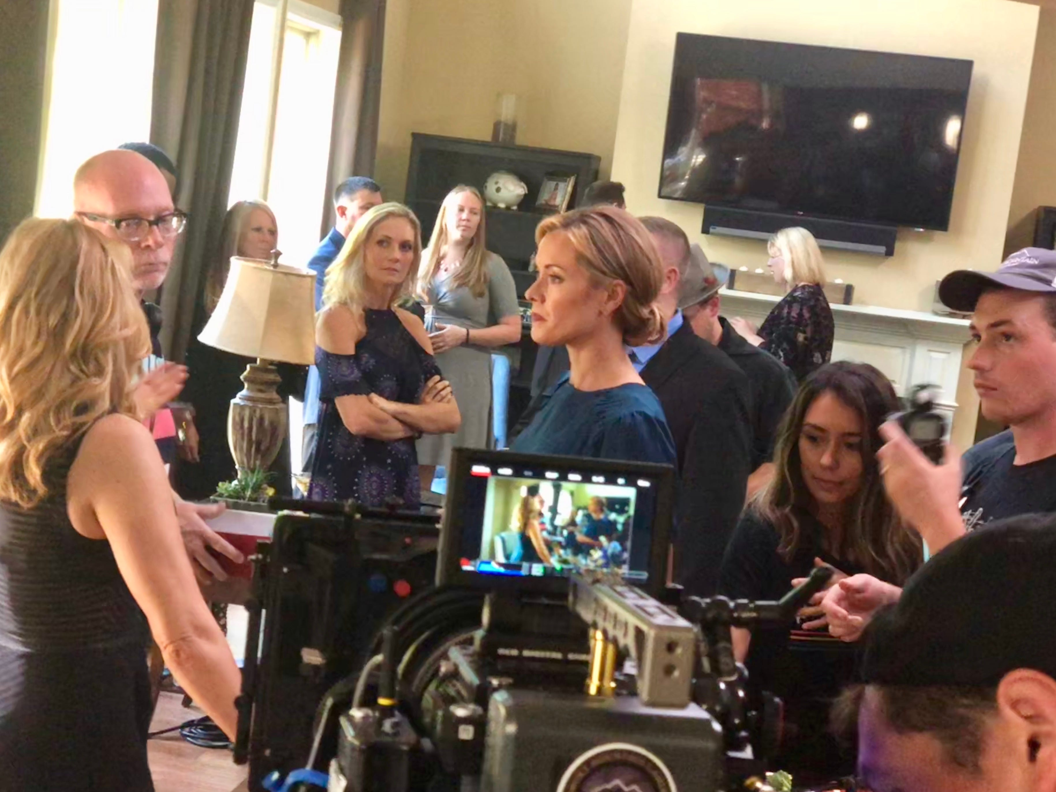 "While filming ""Purity Falls"" in Knoxville, Director Sam Irvin discusses a scene with Olivia d'Abo and Kristanna Loken as director of photography Nate Spicer sets up the next shot."