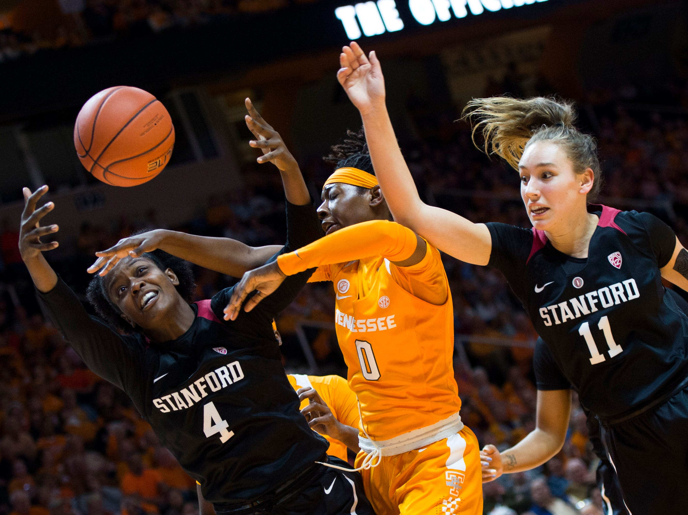 Tennessee's Rennia Davis (0) blocks a shot by a Stanford player during a women's basketball game between Tennessee and Stanford at Thompson-Boling Arena Tuesday, Dec. 18, 2018.