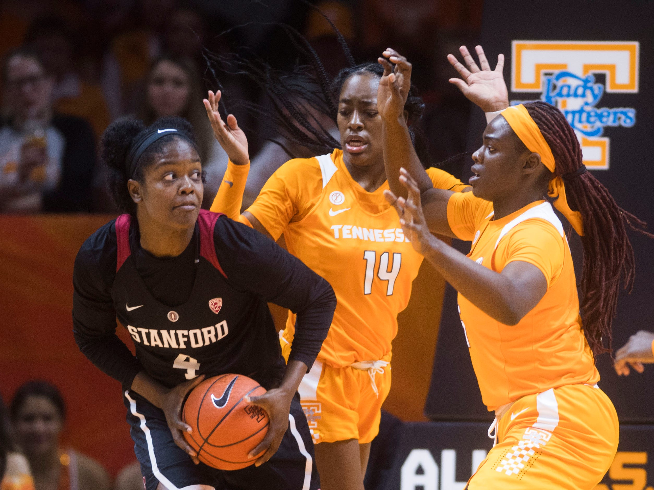 Tennessee's Zaay Green (14) and Tennessee's Cheridene Green (15) defend Standford's Nadia Fingall (4) during a women's basketball game between Tennessee and Stanford at Thompson-Boling Arena Tuesday, Dec. 18, 2018.