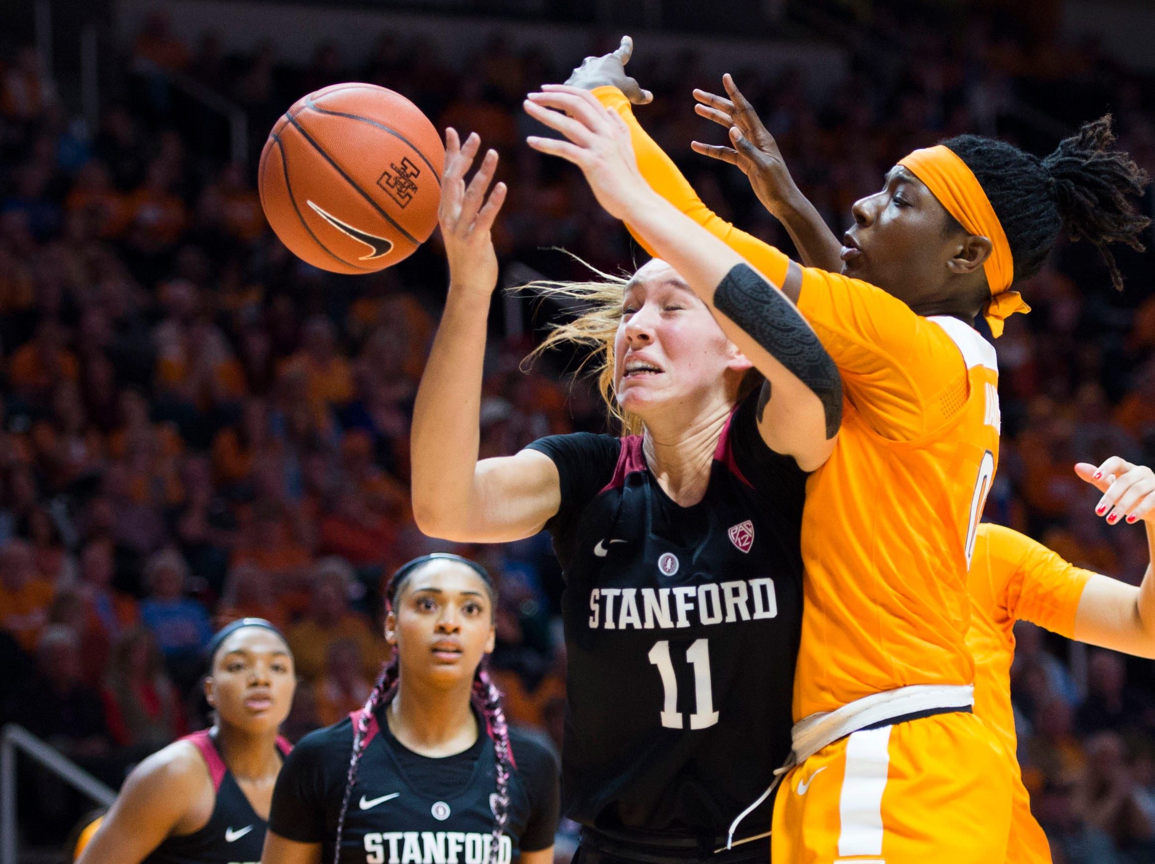 Standford's Alanna Smith (11) defends Tennessee's Rennia Davis (0) during a women's basketball game between Tennessee and Stanford at Thompson-Boling Arena Tuesday, Dec. 18, 2018.