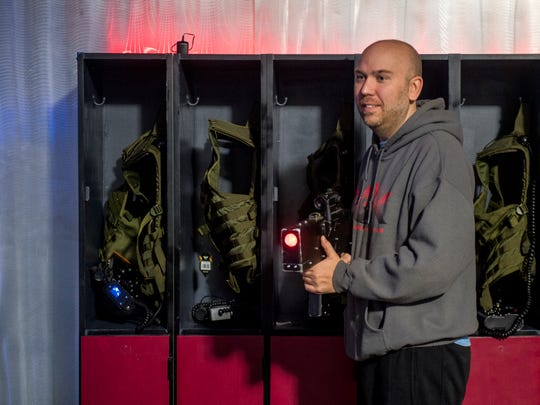 Owner Dustin Wyrick demonstrates a laser tag gun at Next Level Knoxville, located in Knoxville Center Mall, on Dec. 18, 2018.