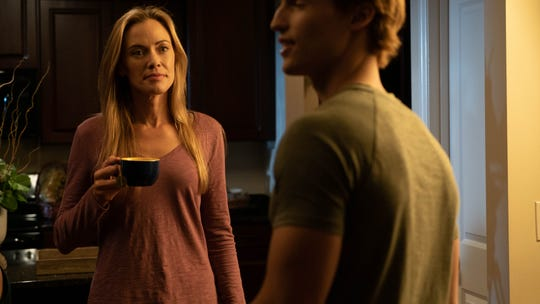"Kristanna Loken and Trevor Stines act in a scene from Knoxville-filmed ""Purity Falls."""