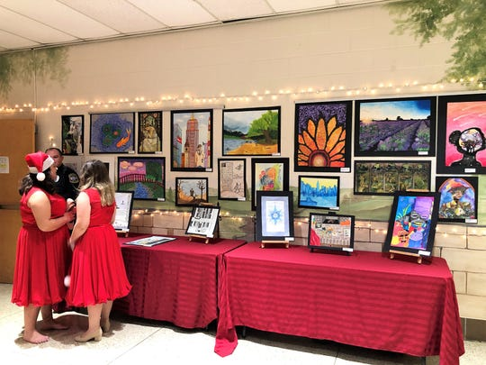 The Fine Arts program showcased their work on the walls outside the auditorium at Halls High School.