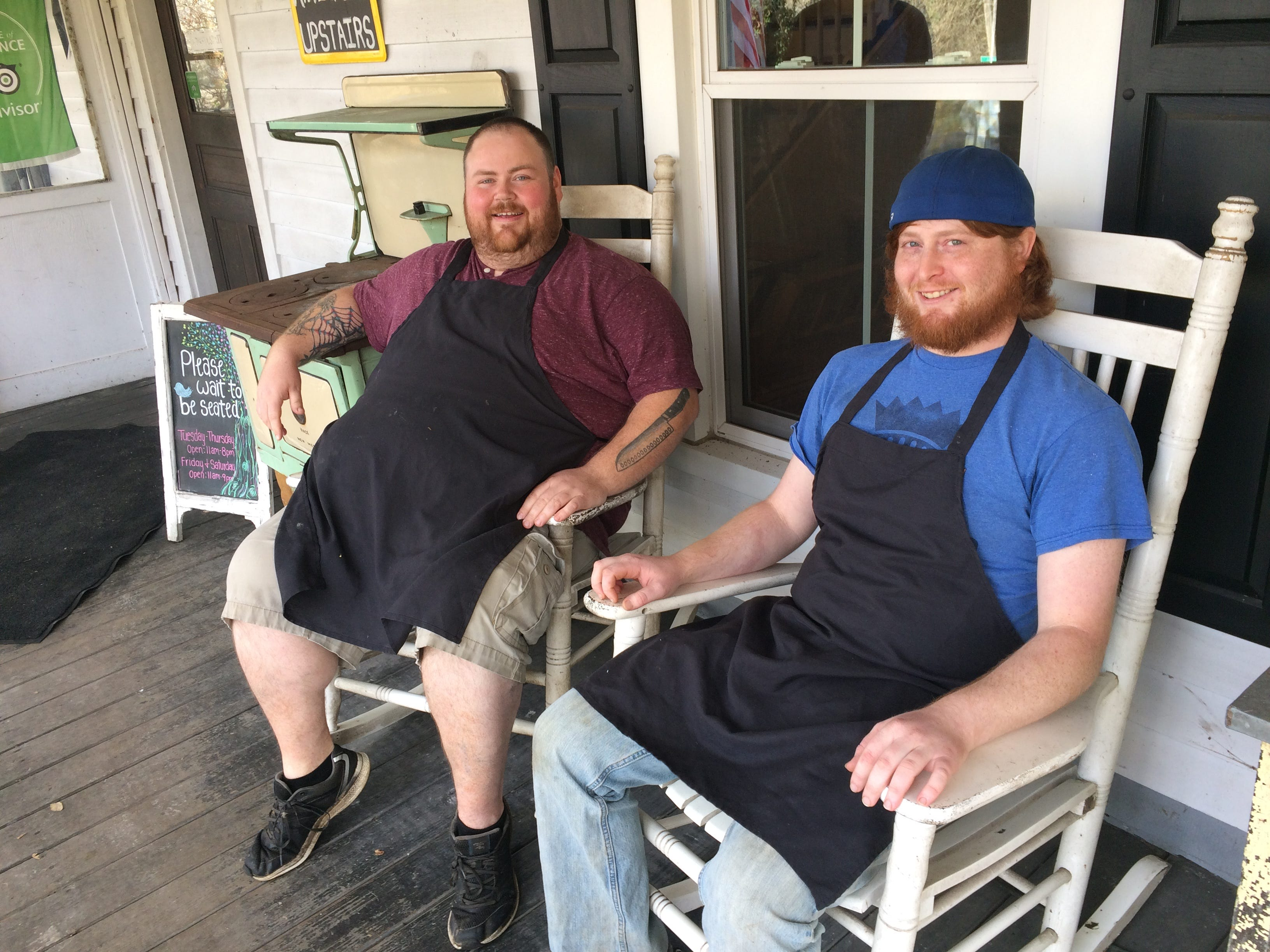 Chef Ken Huddleson, left, and sous chef Jordyn Bough enjoy a moment on the front porch.