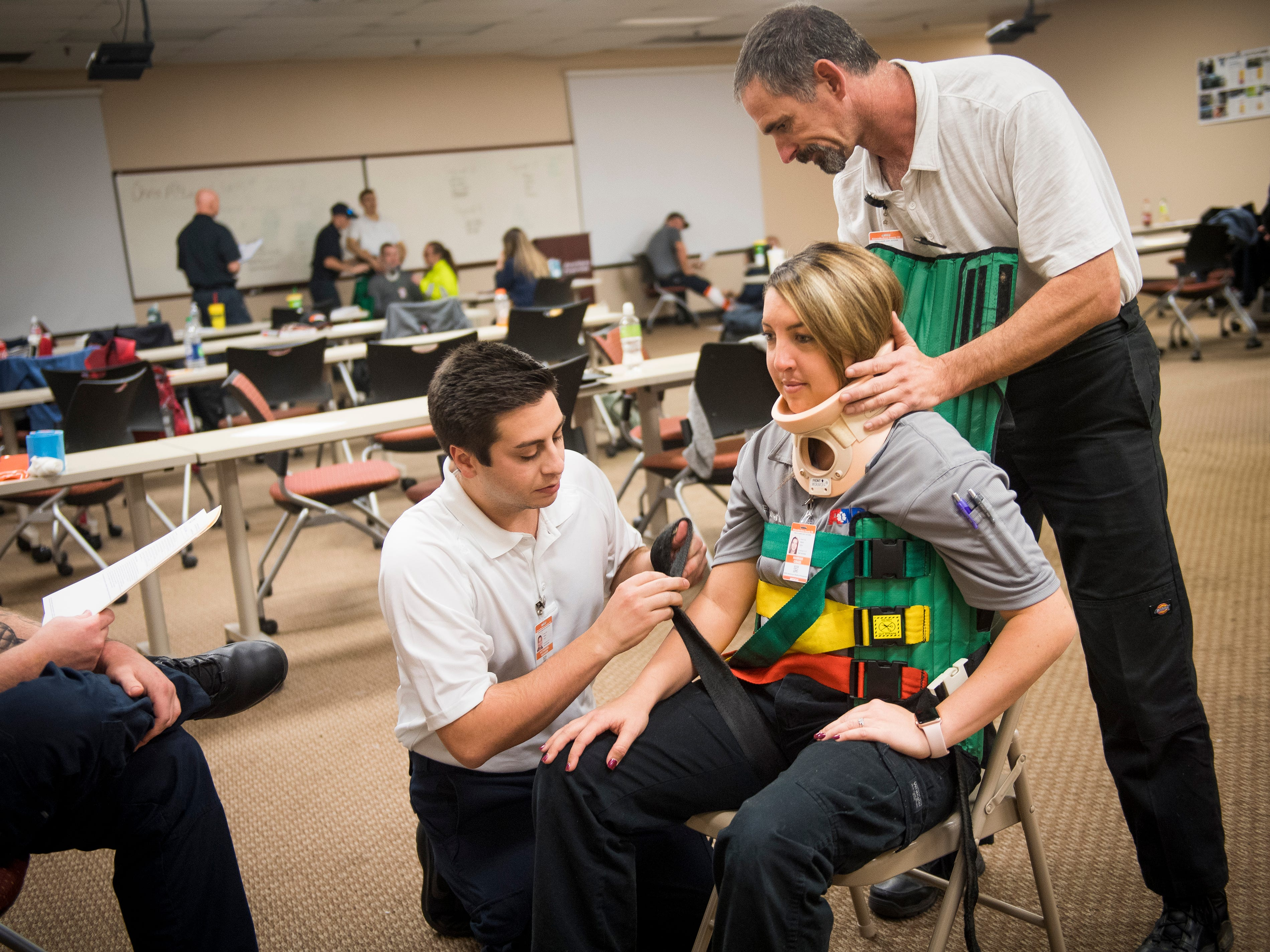 EMT interns practice mobilizing a patient during a cooperative class between AMR and Pellissippi State on Monday, December 3, 2018.