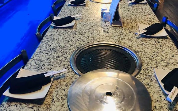Korean grills are built into the table at Hana Grill
