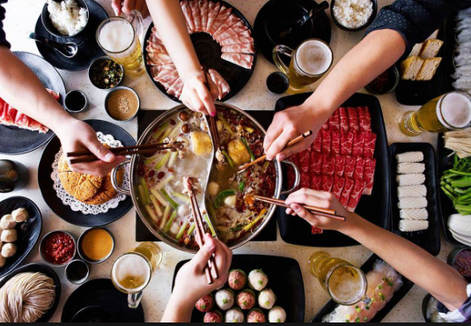 The hot pot communal dining experience is offered at Chopsticks Fresh Asian Cuisine.