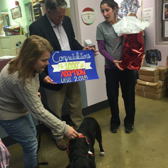 Lisa Everett with Rouger, her daughter Jewel Everett's adopted dog, Ruger, were honored by Mayor-President Joel Robideaux and Shelter Supervisor Shelley Delahoussaye for being the 1000th animal adopted from the shelter in 2018.