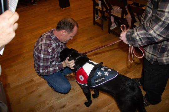 Brad Hutchinson and service dog Razzmic.