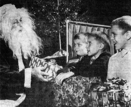 This photo appeared in the E-G on Dec. 21, 1965. Santa attended the Lancaster Rotary Club with presents for children with special needs.