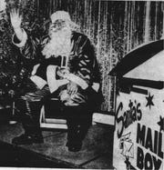 Santa found a new holiday home at the Plaza Shopping Center in 1963. He had a workshop in the rear of the J. C. Penney store. This Duke Ellis photo appeared in the E-G Dec. 3, 1963.