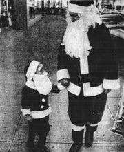 "Santa met his ""match"" in this photo taken by Duke Ellis. It appeared in the E-G on Dec. 12, 1973."
