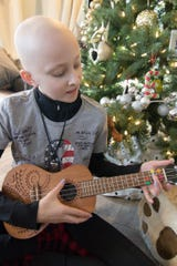 Emma Roberts, 13, plays the ukulele, a Christmas gift from a friend, on Monday, Dec. 17, 2018.