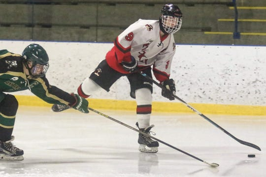 Tyler Horvath (9) had a goal and two assists for Pinckney in an 8-6 loss to Ann Arbor Huron on Tuesday, Dec. 18, 2018.