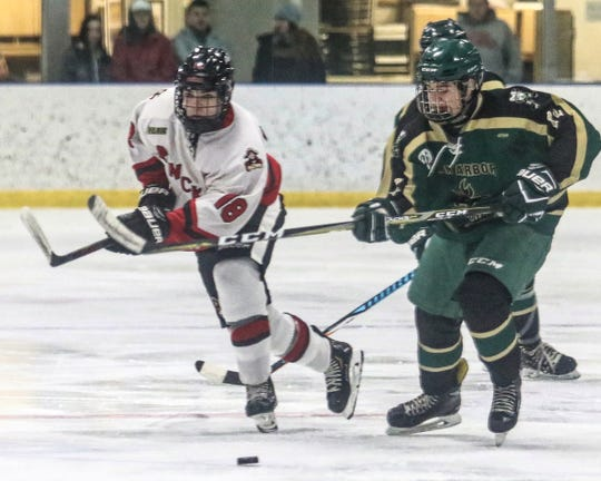 Austin Selmi (18) scored twice for Pinckney in an 8-6 loss to Ann Arbor Huron on Tuesday, Dec. 18, 2018.