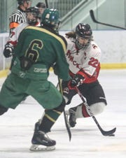 "Pinckney senior Valen LeVasseur (22) said losing is ""more of a hit on the chin"" than it's been in the past."