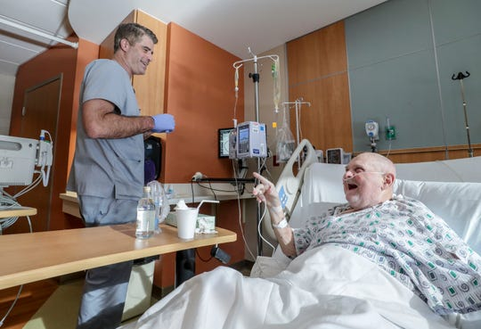 Bart Conley (left) shares a laugh with George Grider in the oncology unit at Norton Women's & Children's Hospital.