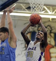 Male's Richard White is fouled by Collins' Sam Edward going up for a shot.