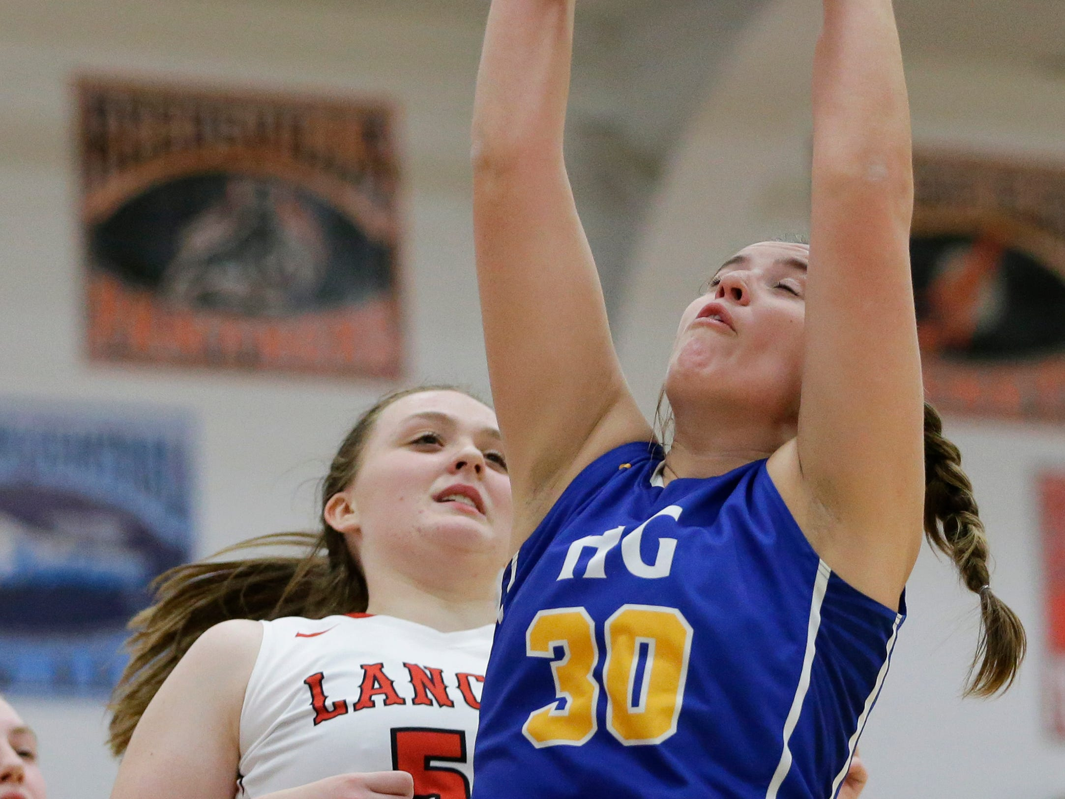 Howards Grove's Sara Marten rebounds against Manitowoc Lutheran at Manitowoc Lutheran High School Tuesday, December 18, 2018, in Manitowoc, Wis. Joshua Clark/USA TODAY NETWORK-Wisconsin
