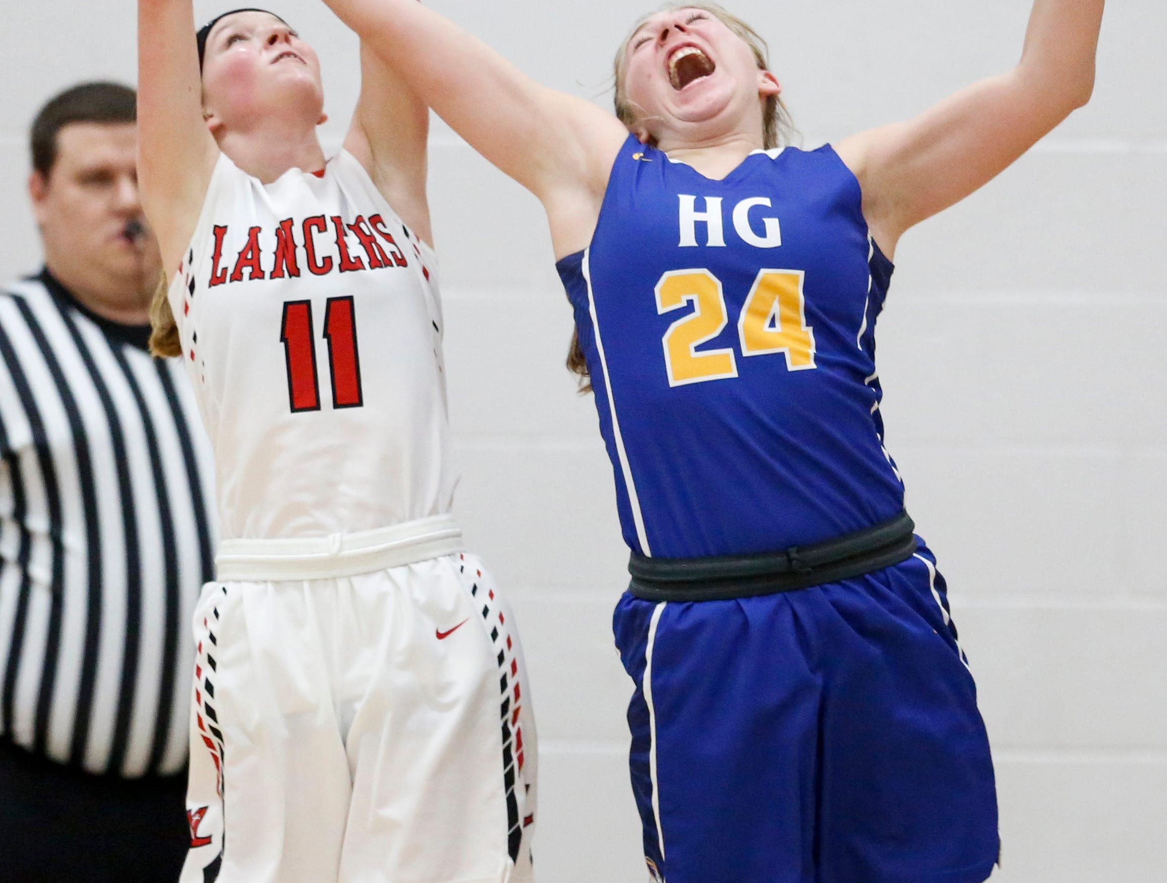 Manitowoc Lutheran's Lydia Hecker battles Howards Grove's Kayla Bender for a rebound at Manitowoc Lutheran High School Tuesday, December 18, 2018, in Manitowoc, Wis. Joshua Clark/USA TODAY NETWORK-Wisconsin