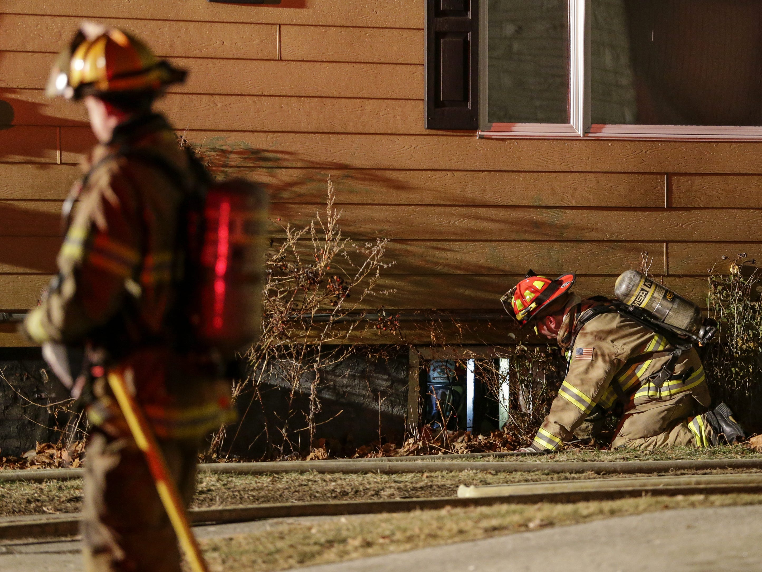 Firefighters respond to a fire at 1129 South 25th Street Tuesday, December 18, 2018, in Manitowoc, Wis.