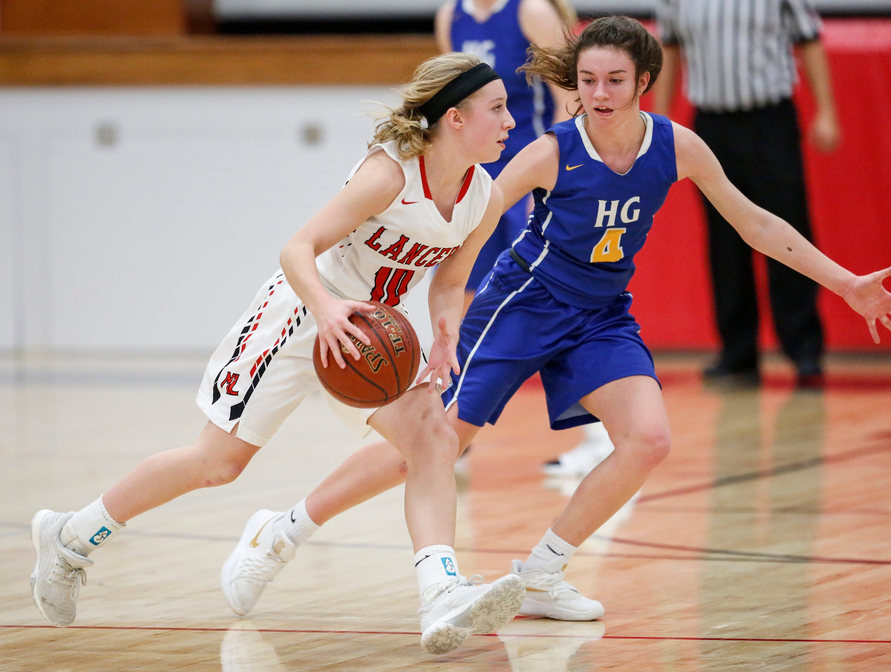 Manitowoc Lutheran's Mady Hurkmans against Howards Grove's Mackenzie Holzwart at Manitowoc Lutheran High School Tuesday, December 18, 2018, in Manitowoc, Wis. Joshua Clark/USA TODAY NETWORK-Wisconsin