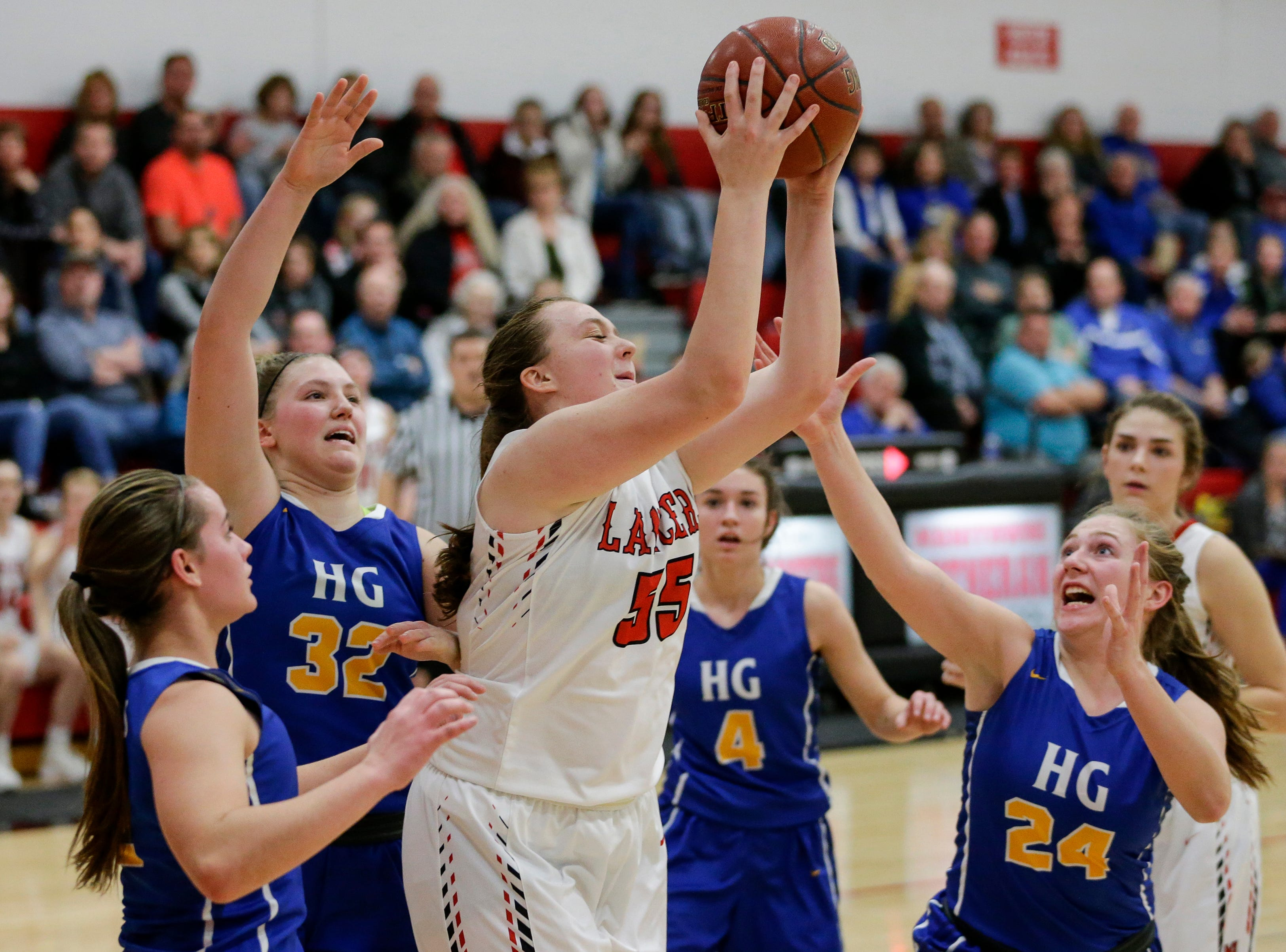 Manitowoc Lutheran's MonRaye Ermis rebounds against Howards Grove at Manitowoc Lutheran High School Tuesday, December 18, 2018, in Manitowoc, Wis. Joshua Clark/USA TODAY NETWORK-Wisconsin