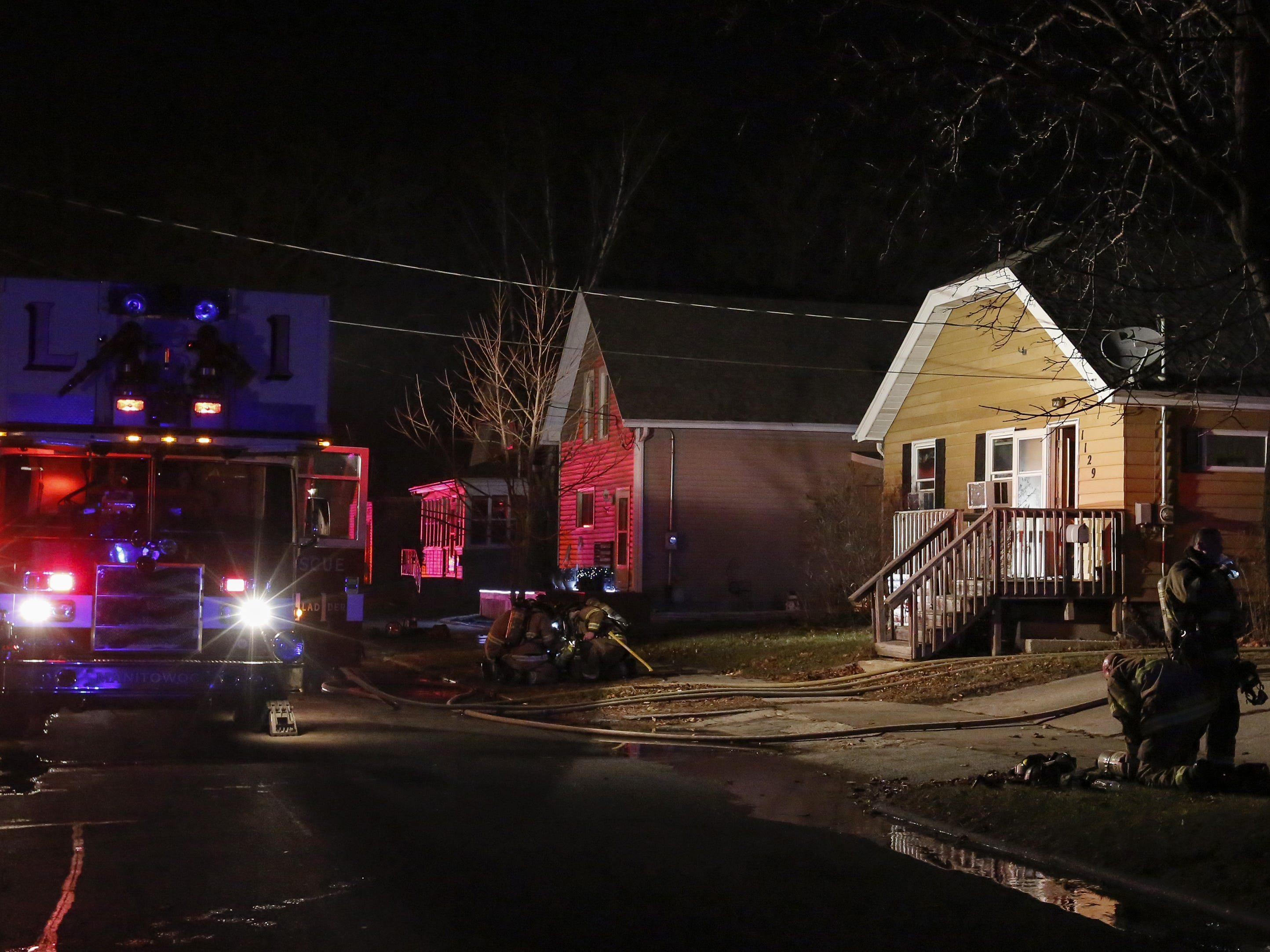 Firefighters respond to a fire at 1129 South 25th Street Tuesday, December 18, 2018, in Manitowoc.