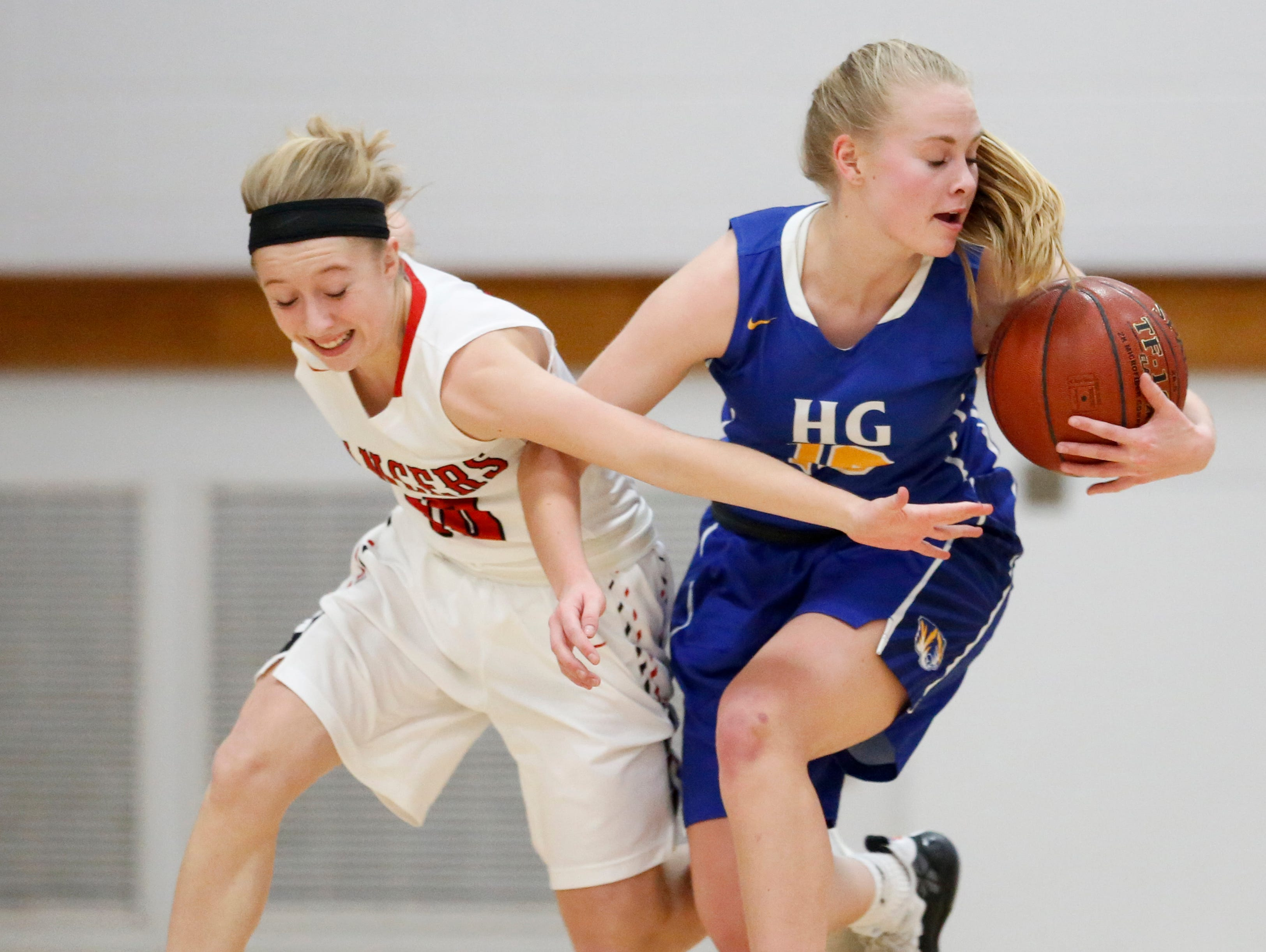 Howards Grove's Leah Parnitzke wins a loose ball from Manitowoc Lutheran's Mady Hurkmans at Manitowoc Lutheran High School Tuesday, December 18, 2018, in Manitowoc, Wis. Joshua Clark/USA TODAY NETWORK-Wisconsin