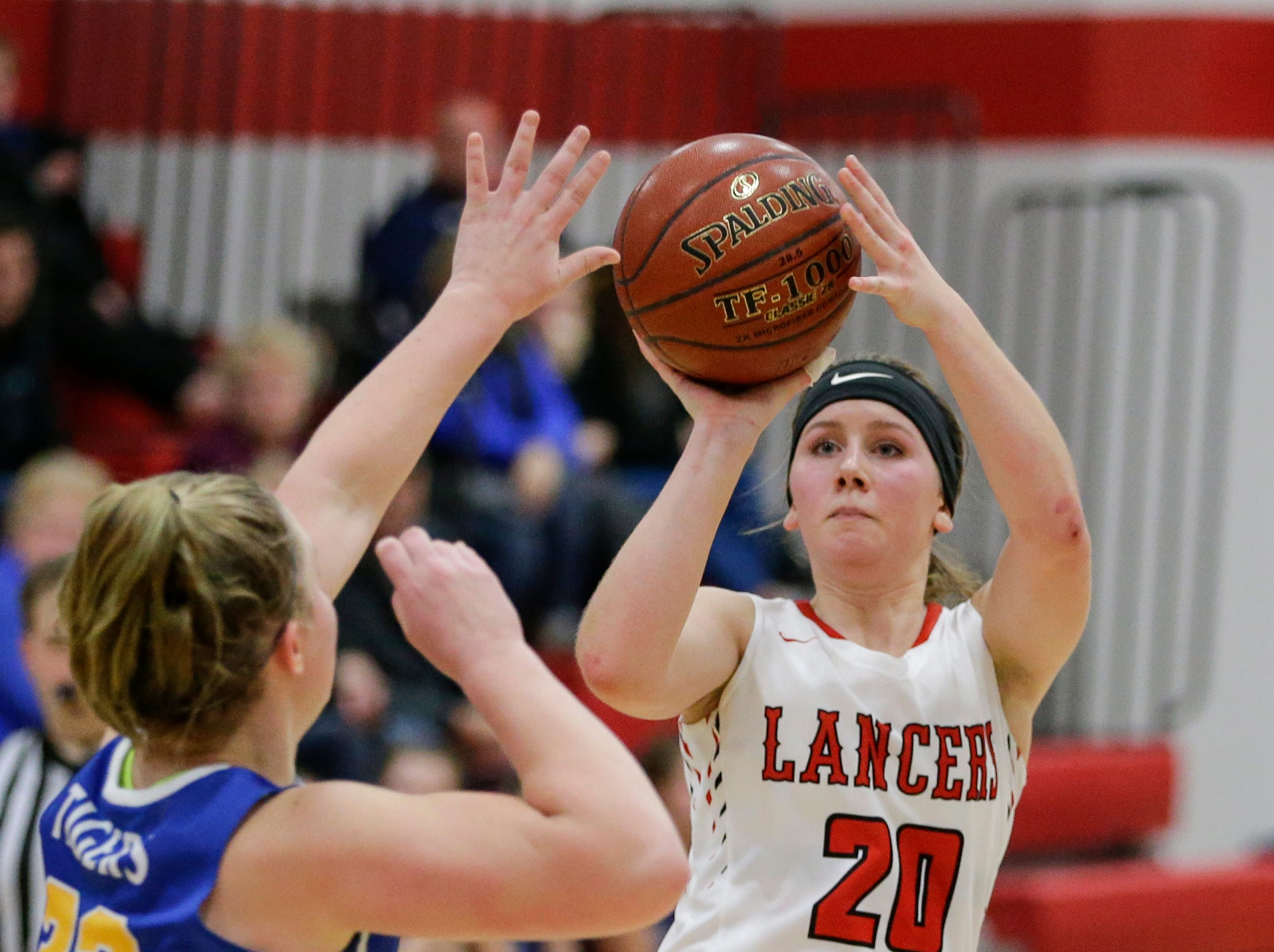 Manitowoc Lutheran's Grace Melso shoots a three against Howards Grove at Manitowoc Lutheran High School Tuesday, December 18, 2018, in Manitowoc, Wis. Joshua Clark/USA TODAY NETWORK-Wisconsin