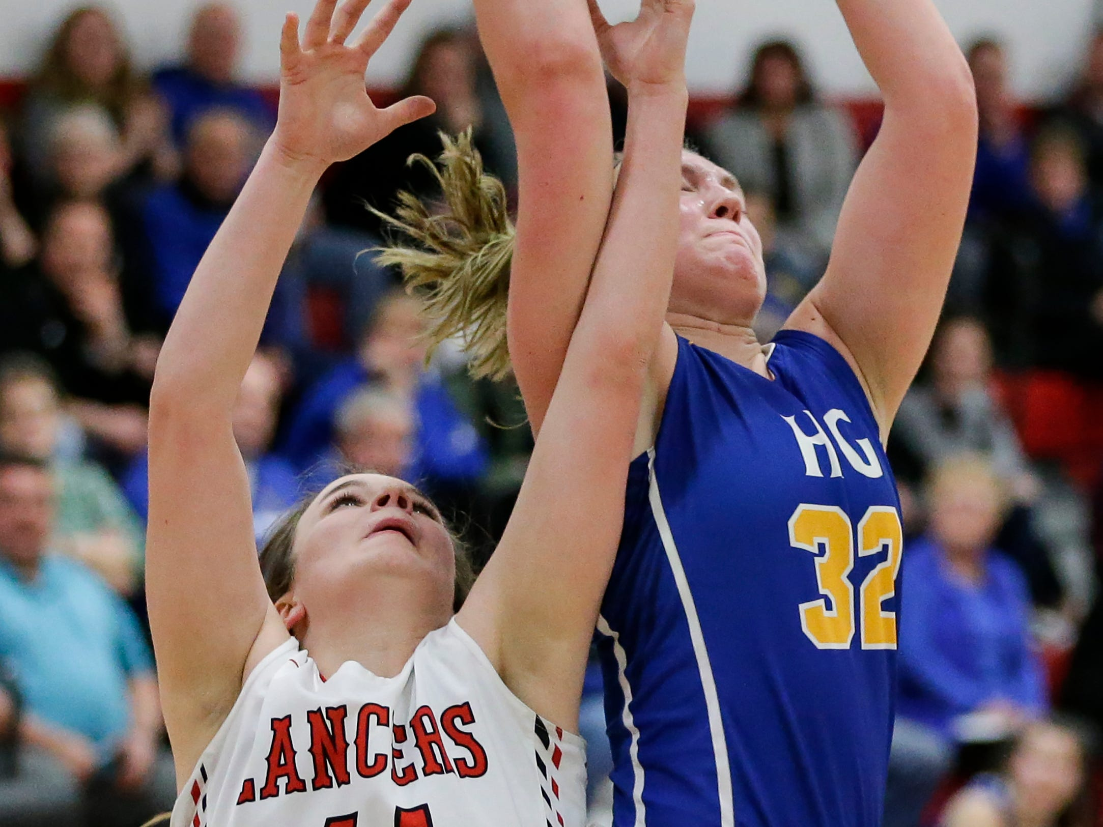 Howards Grove's Madalynn Near rebounds over Manitowoc Lutheran's Katelyn Fels at Manitowoc Lutheran High School Tuesday, December 18, 2018, in Manitowoc, Wis. Joshua Clark/USA TODAY NETWORK-Wisconsin