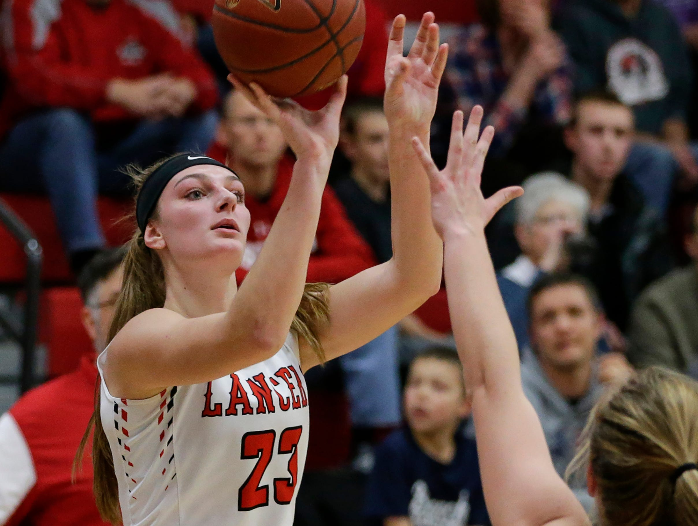 Manitowoc Lutheran's Emily Behnke puts up a jumpshot against Howards Grove at Manitowoc Lutheran High School Tuesday, December 18, 2018, in Manitowoc, Wis. Joshua Clark/USA TODAY NETWORK-Wisconsin