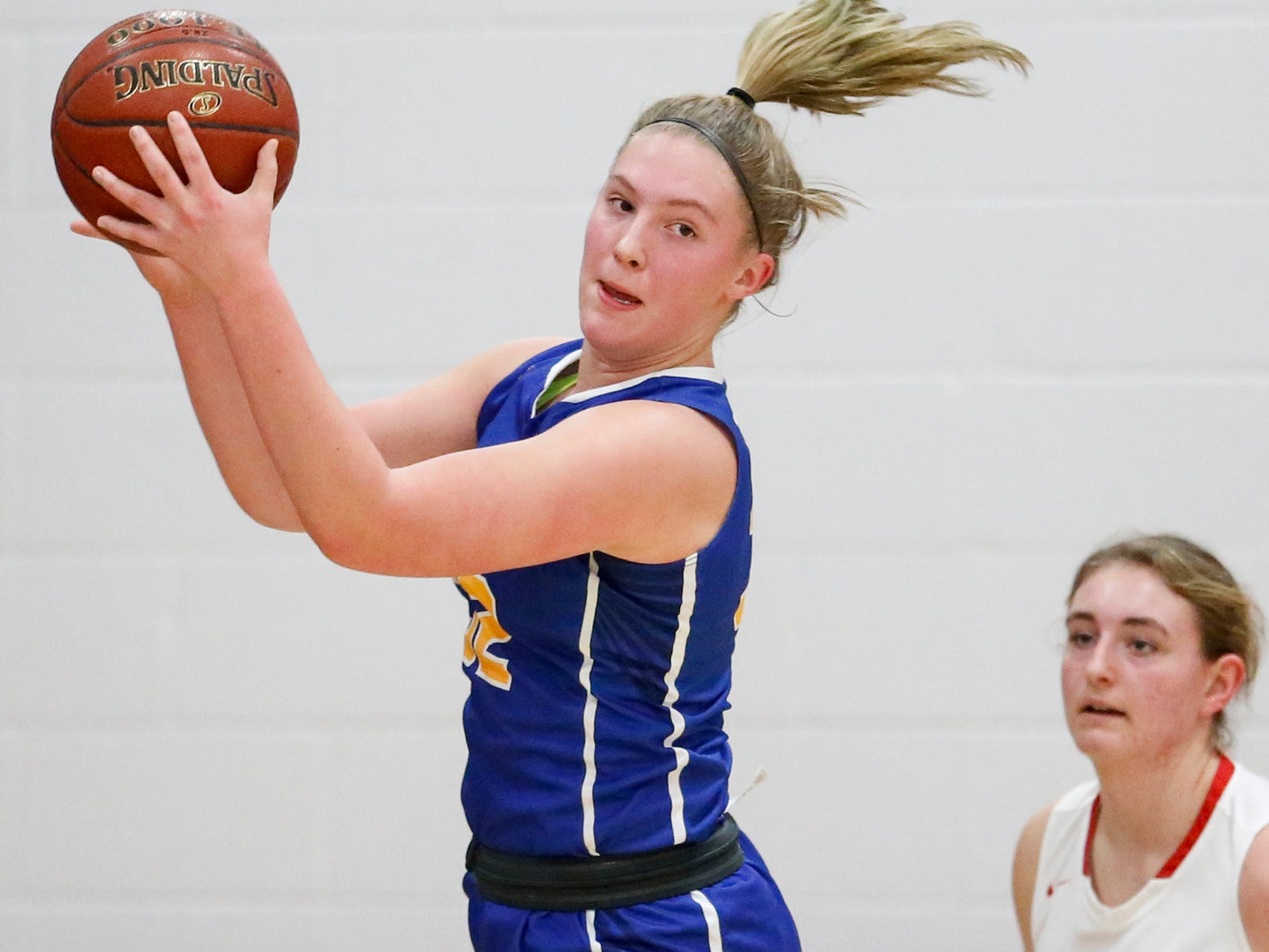 Howards Grove's Madalynn Near grabs a rebound against Manitowoc Lutheran at Manitowoc Lutheran High School Tuesday, December 18, 2018, in Manitowoc, Wis. Joshua Clark/USA TODAY NETWORK-Wisconsin