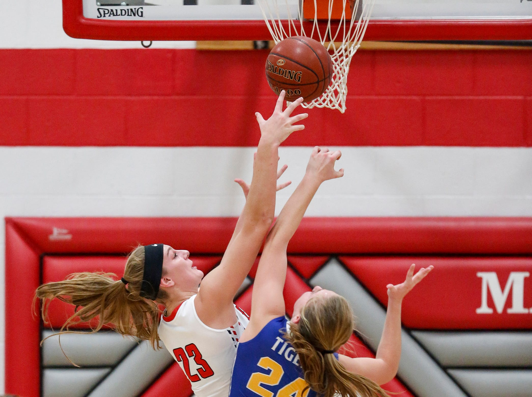 Manitowoc Lutheran's Emily Behnke beats Howards Grove's Kayla Bender for a rebound at Manitowoc Lutheran High School Tuesday, December 18, 2018, in Manitowoc, Wis. Joshua Clark/USA TODAY NETWORK-Wisconsin