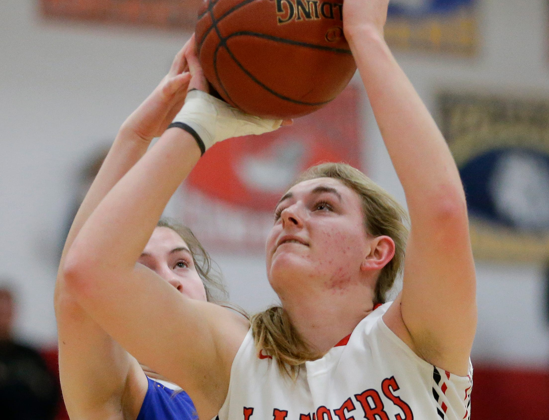 Manitowoc Lutheran's Allison Menges shoots against Howards Grove at Manitowoc Lutheran High School Tuesday, December 18, 2018, in Manitowoc, Wis. Joshua Clark/USA TODAY NETWORK-Wisconsin