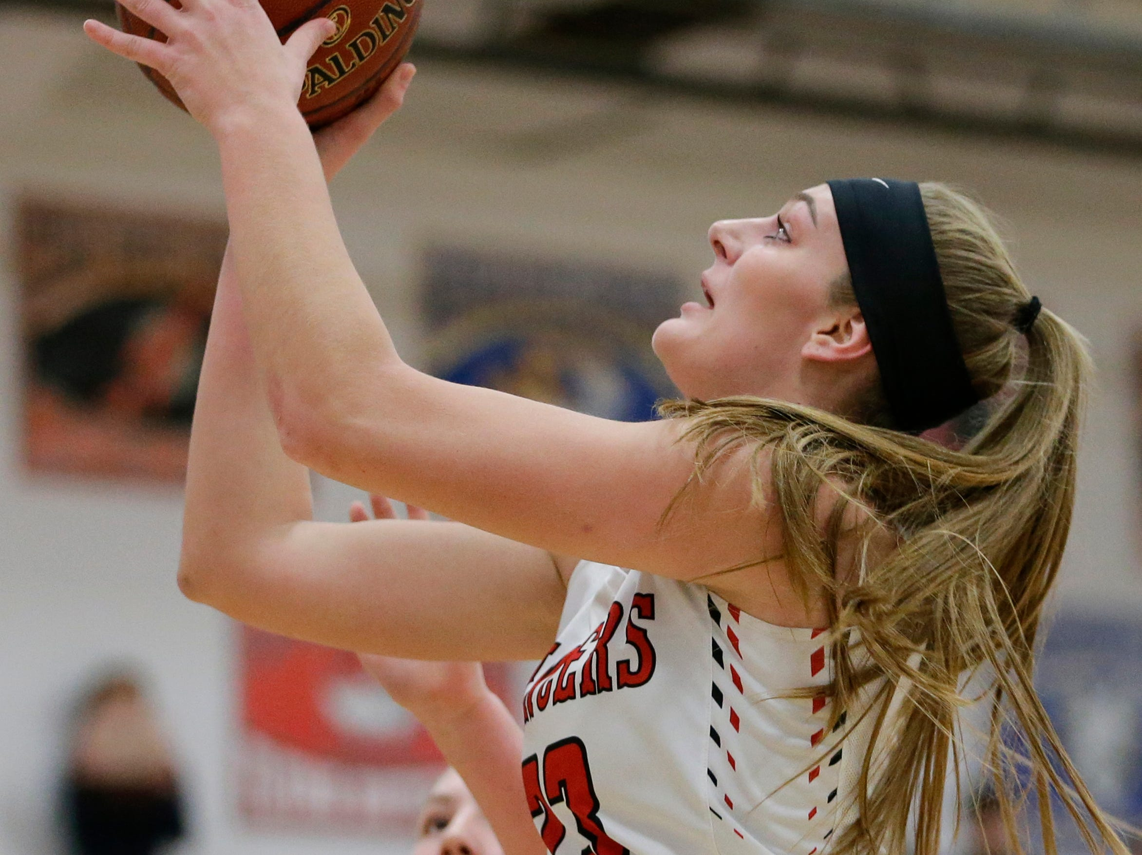 Manitowoc Lutheran's Emily Behnke shoots against Howards Grove at Manitowoc Lutheran High School Tuesday, December 18, 2018, in Manitowoc, Wis. Joshua Clark/USA TODAY NETWORK-Wisconsin