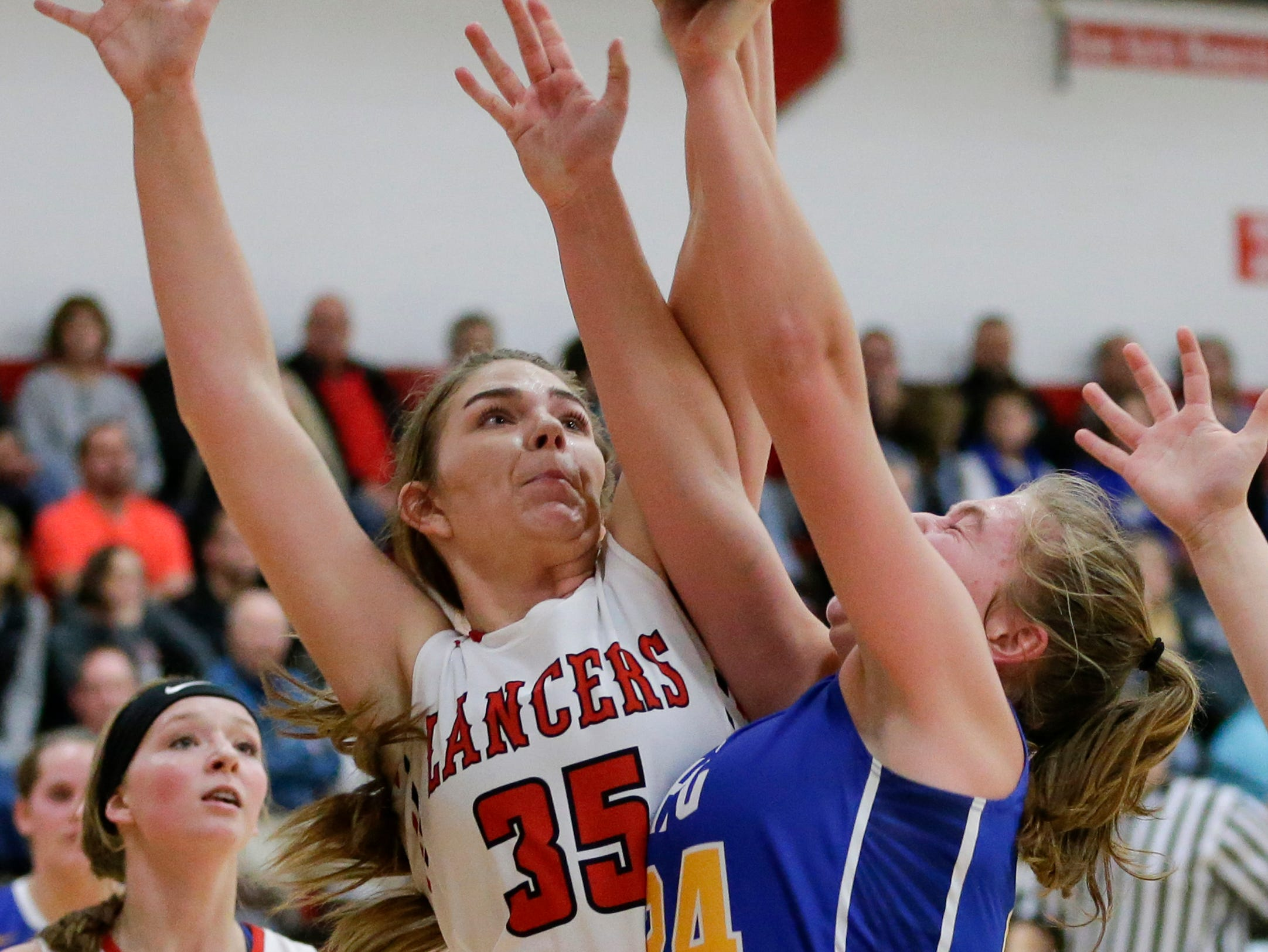 Manitowoc Lutheran's Madison Gorte blocks a shot from Howards Grove's Kayla Bender at Manitowoc Lutheran High School Tuesday, December 18, 2018, in Manitowoc, Wis. Joshua Clark/USA TODAY NETWORK-Wisconsin