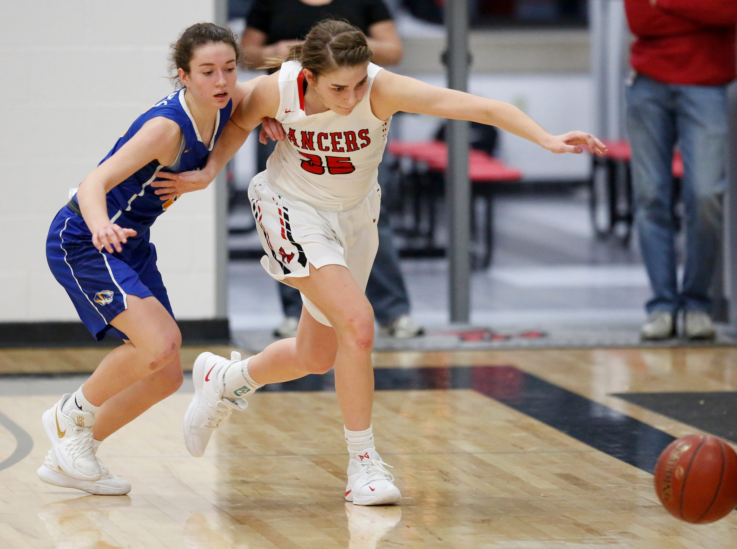 Manitowoc Lutheran's Madison Gorte fends off Howards Grove's Mackenzie Holzwart for a loose ball at Manitowoc Lutheran High School Tuesday, December 18, 2018, in Manitowoc, Wis. Joshua Clark/USA TODAY NETWORK-Wisconsin