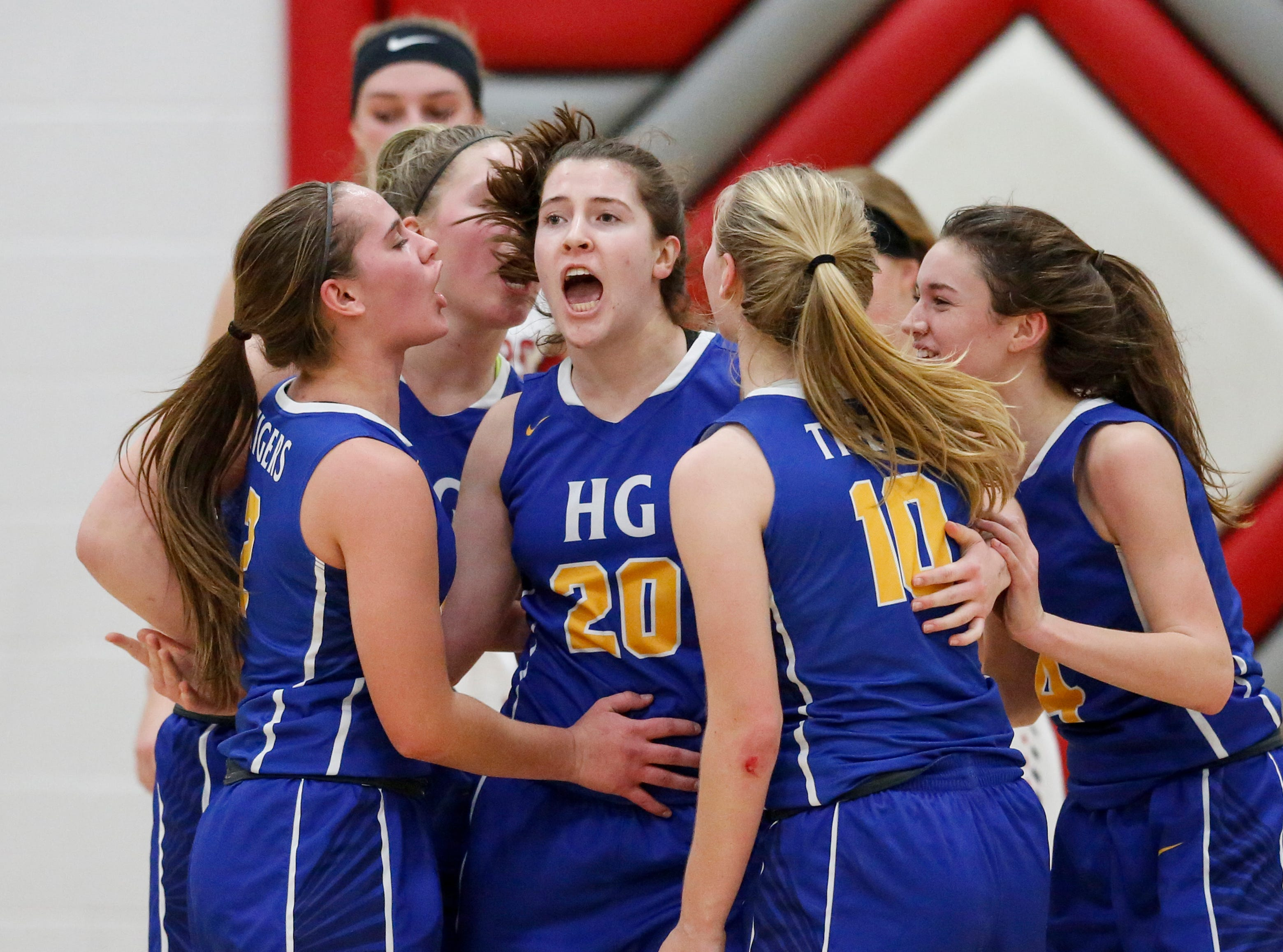 Howards Grove's Courtney Binversie reacts after scoring against Manitowoc Lutheran at Manitowoc Lutheran High School Tuesday, December 18, 2018, in Manitowoc, Wis. Joshua Clark/USA TODAY NETWORK-Wisconsin