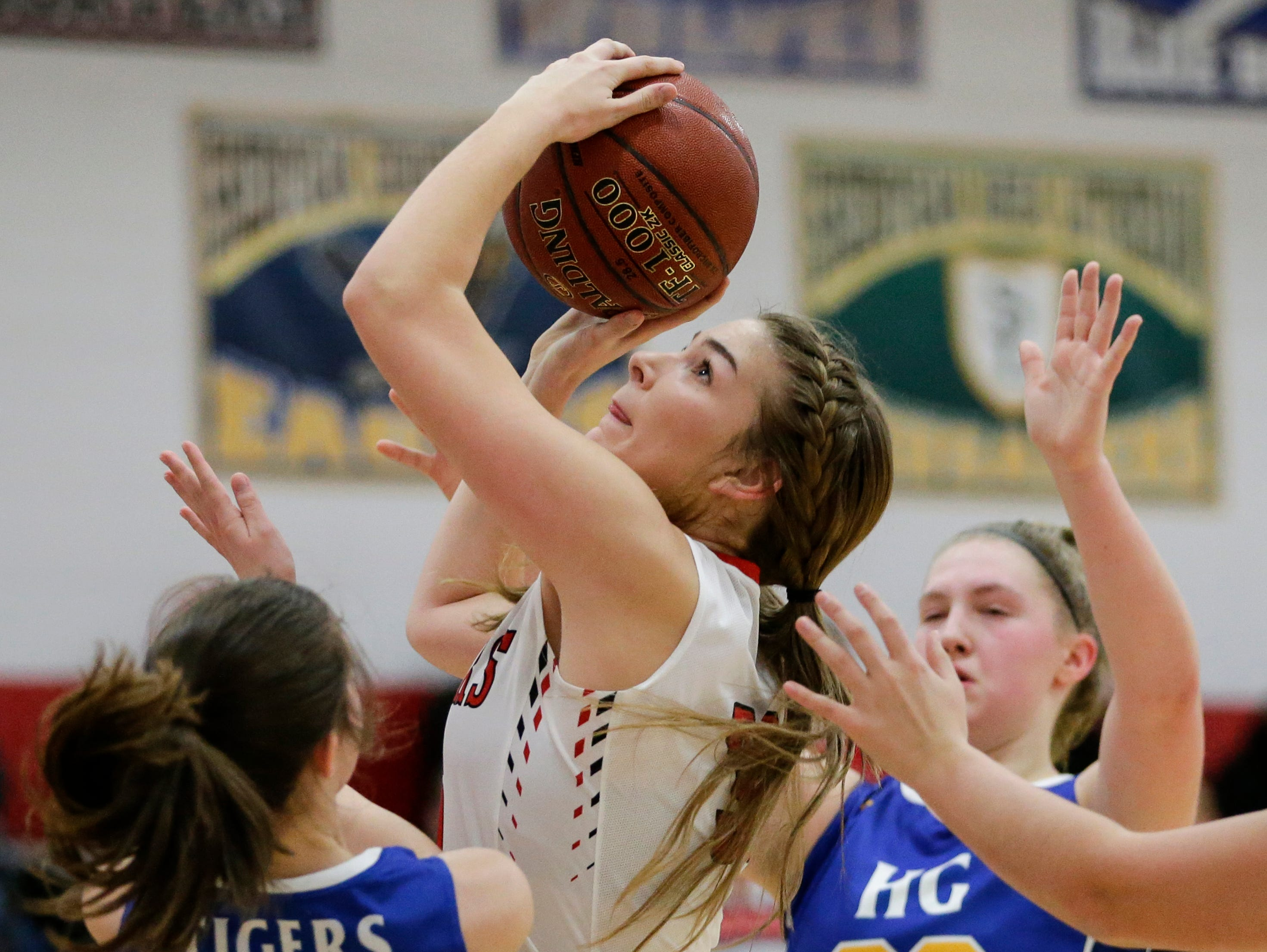 Manitowoc Lutheran's Madison Gorte goes up for a shot against Howards Grove at Manitowoc Lutheran High School Tuesday, December 18, 2018, in Manitowoc, Wis. Joshua Clark/USA TODAY NETWORK-Wisconsin