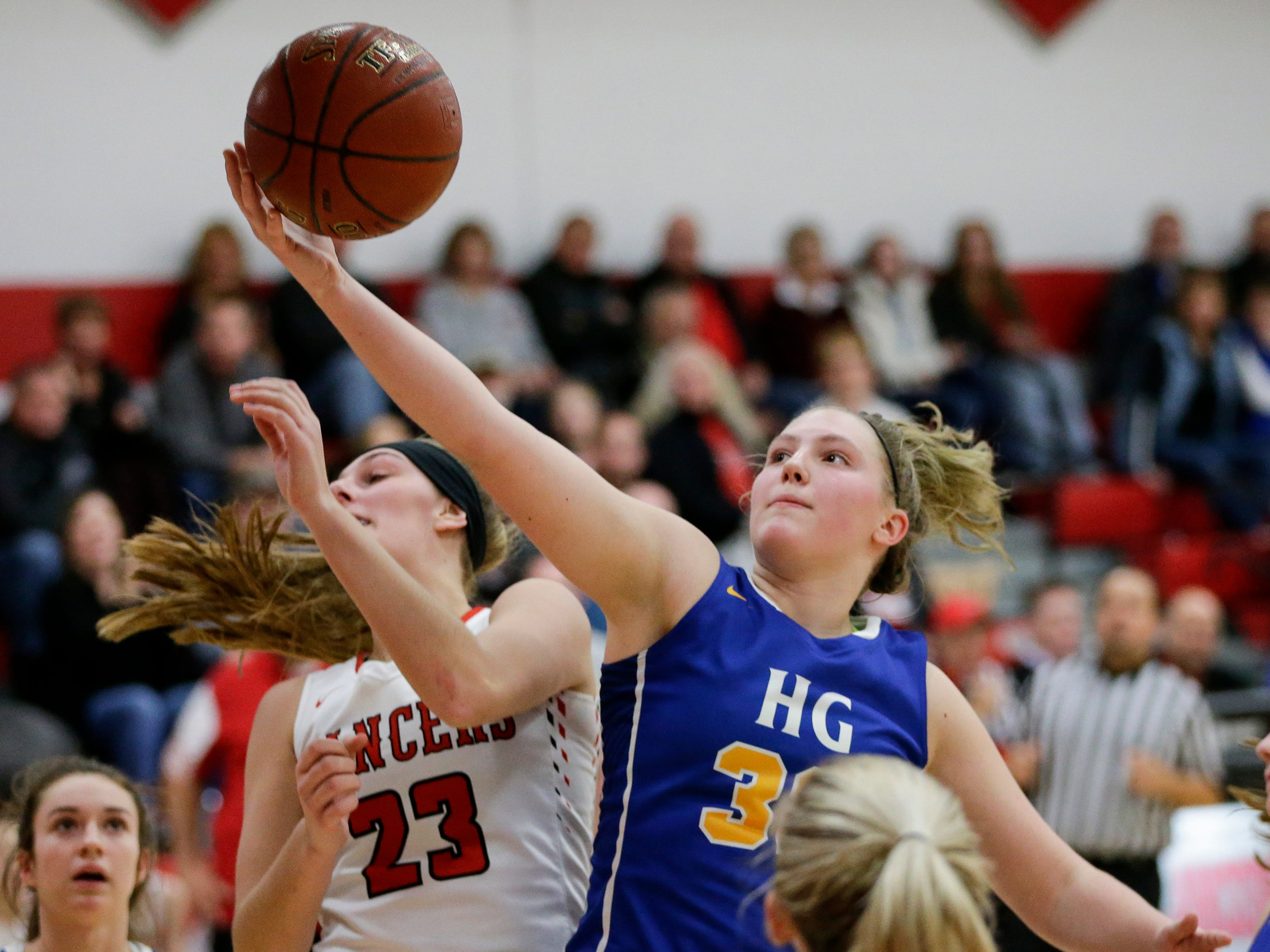 Howards Grove's Madalynn Near rebounds over Manitowoc Lutheran at Manitowoc Lutheran High School Tuesday, December 18, 2018, in Manitowoc, Wis. Joshua Clark/USA TODAY NETWORK-Wisconsin