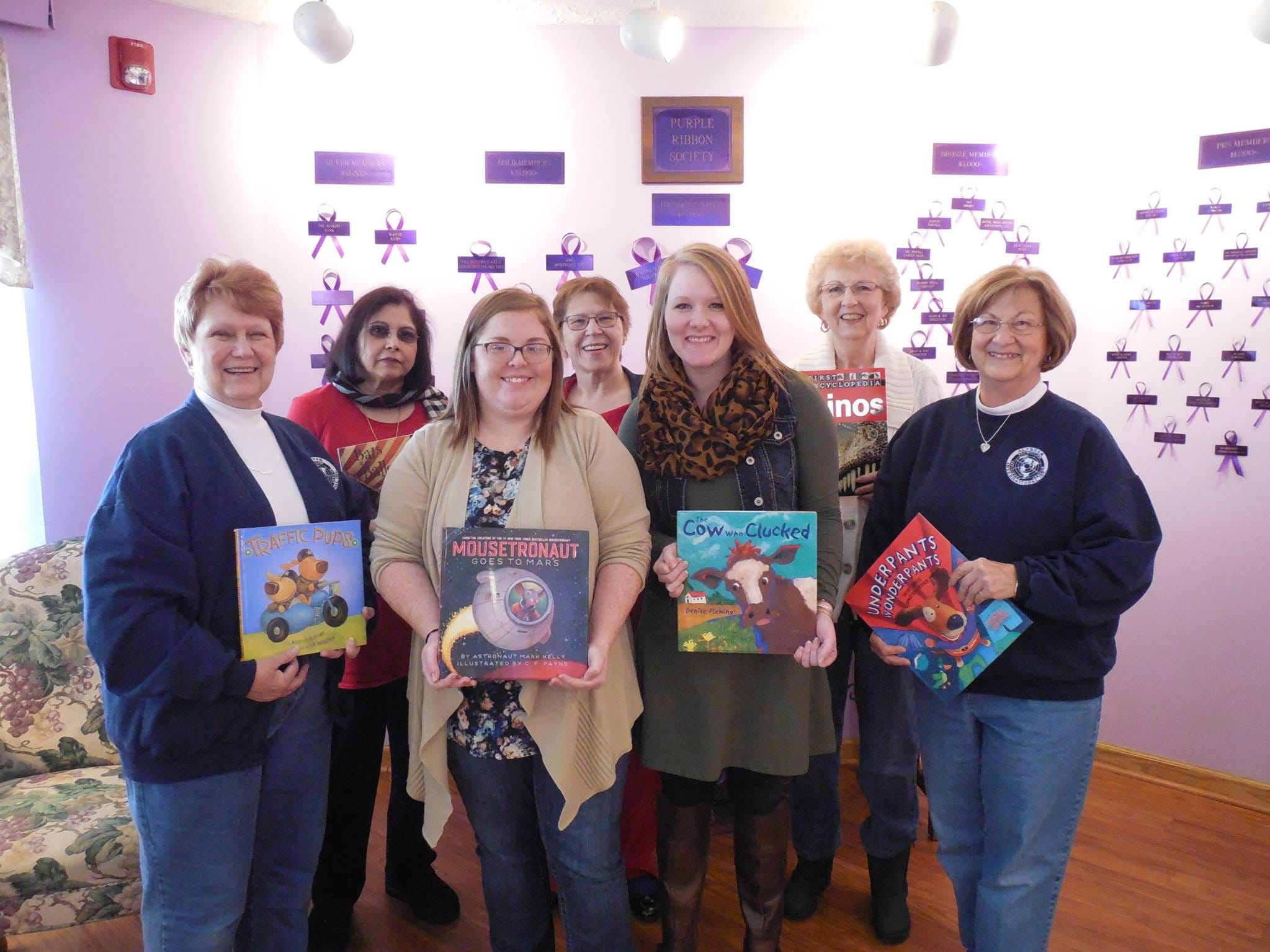 Turning Point is supported locally by numerous donations. Here, members of the Marion Altrusa Club donate children's books to the shelter's library.