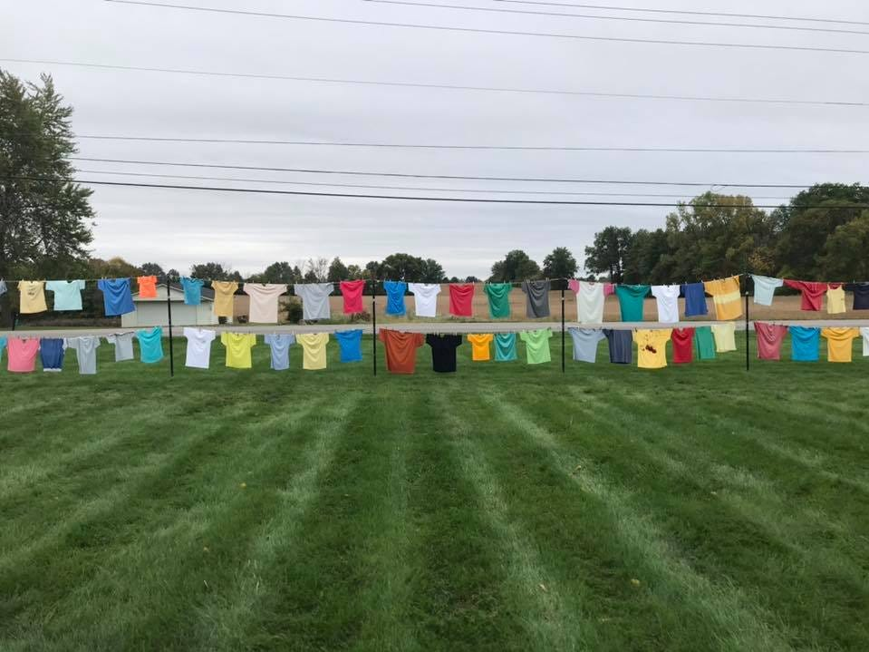Annually, Turning Point participates in the National Clothesline Project to create awareness for domestic violence issues. The colorful line of shirts is displayed on the Barks Road shelter's front lawn.