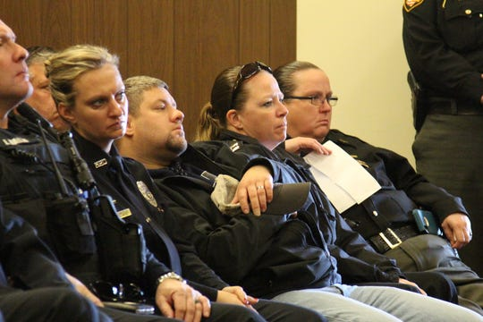"Major Christy Utley, far right, of the Marion County Sheriff's Office, is one of the two officers involved in a firefight with Matthew W. Lust, 33, on July 3. ""You made us do what we all train to do but in the back of our minds, we always hope that we will never have to (do),"" she told Lust at his sentencing."