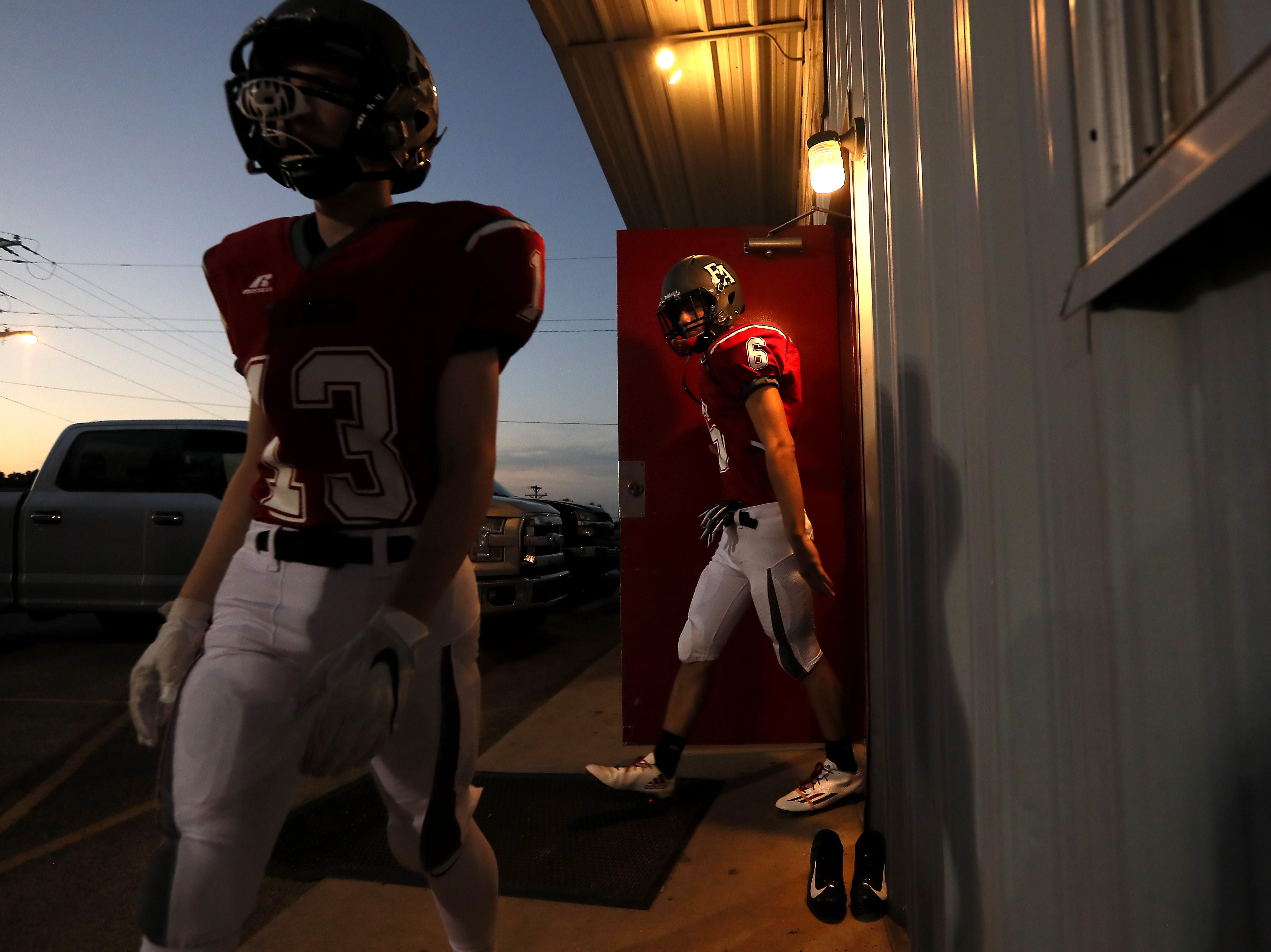 Fayette Academy's Lane Phillips, left, and Cody Bullock head out on to the field to play Davidson Academy in Somerville on Thursday, Oct. 4, 2018.