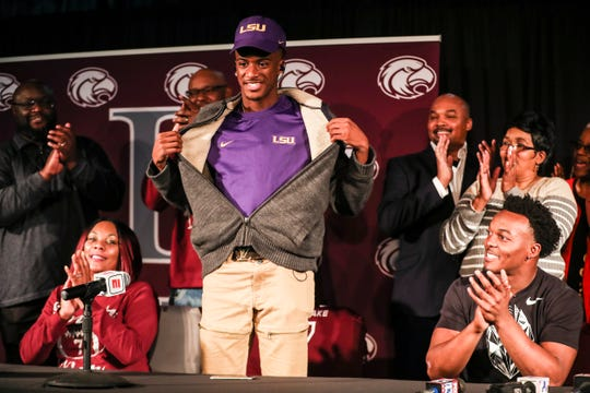 December 19 2018 - Raydarious Jones shows off his LSU apparel after committing to the school doing an announcement on Wednesday at Horn Lake High School.