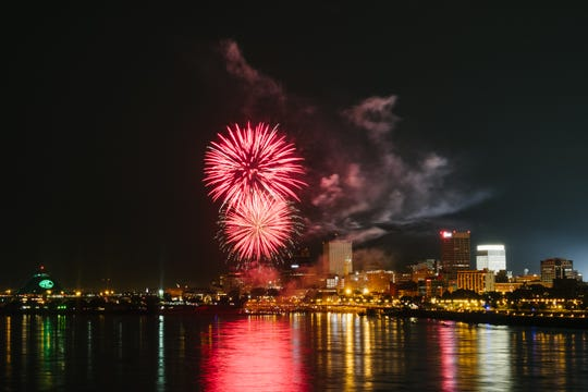 Fireworks, as seen from Big River Crossing, errupt in front of the Downtown Memphis skyline for the 2018 Independence Day Fireworks Spectacular.