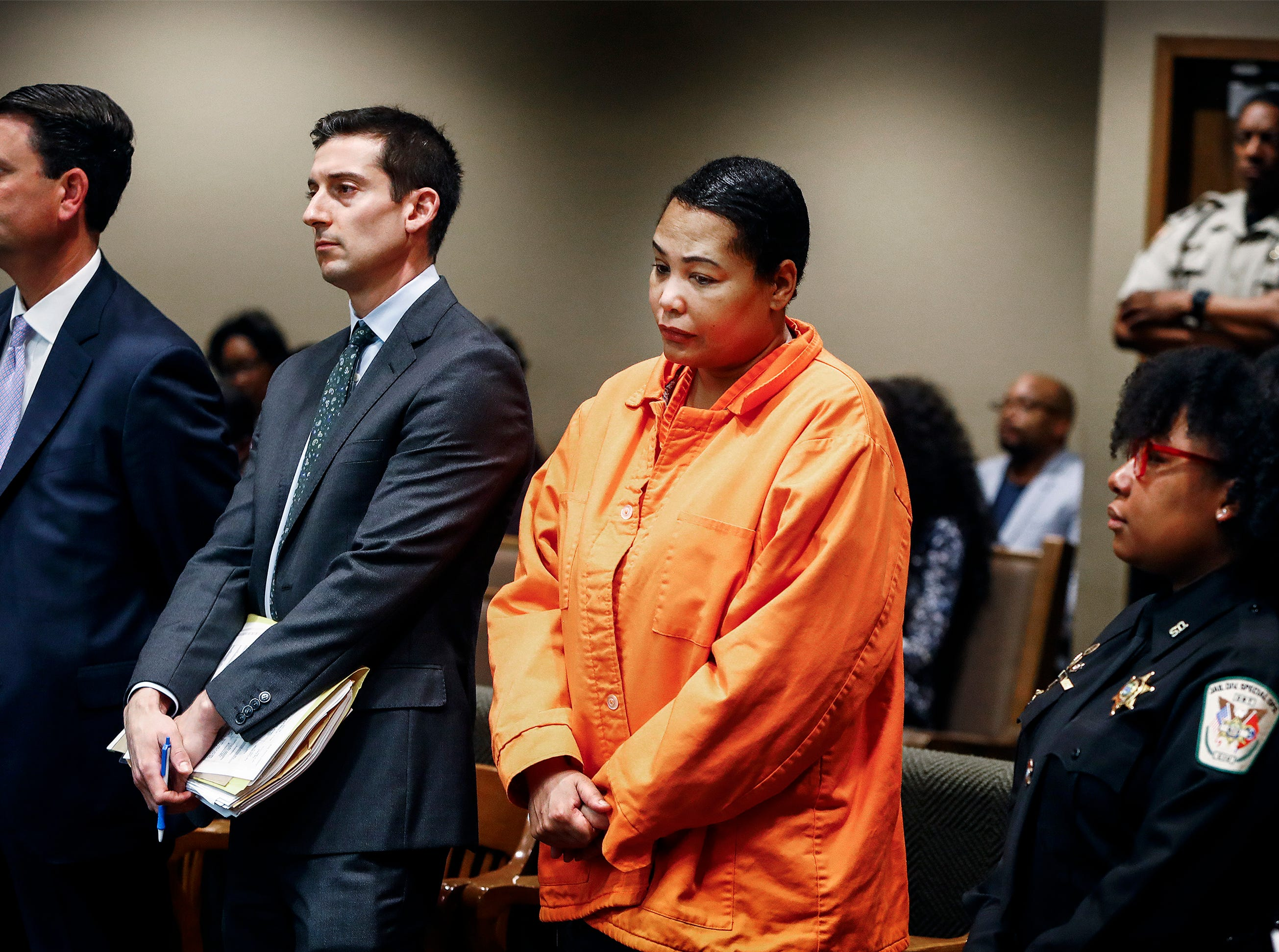 Sherra Wright (right) along with her attorneys Steve Farese Jr. (left) and Blake Ballin (middle) makes a appearance in Judge Lee Coffee's courtroom Monday morning. The prosecutors announced they will not seek the death penalty against Wright and co-defendant Billy Turner, who are charged in the killing of former NBA player Lorenzen Wright.