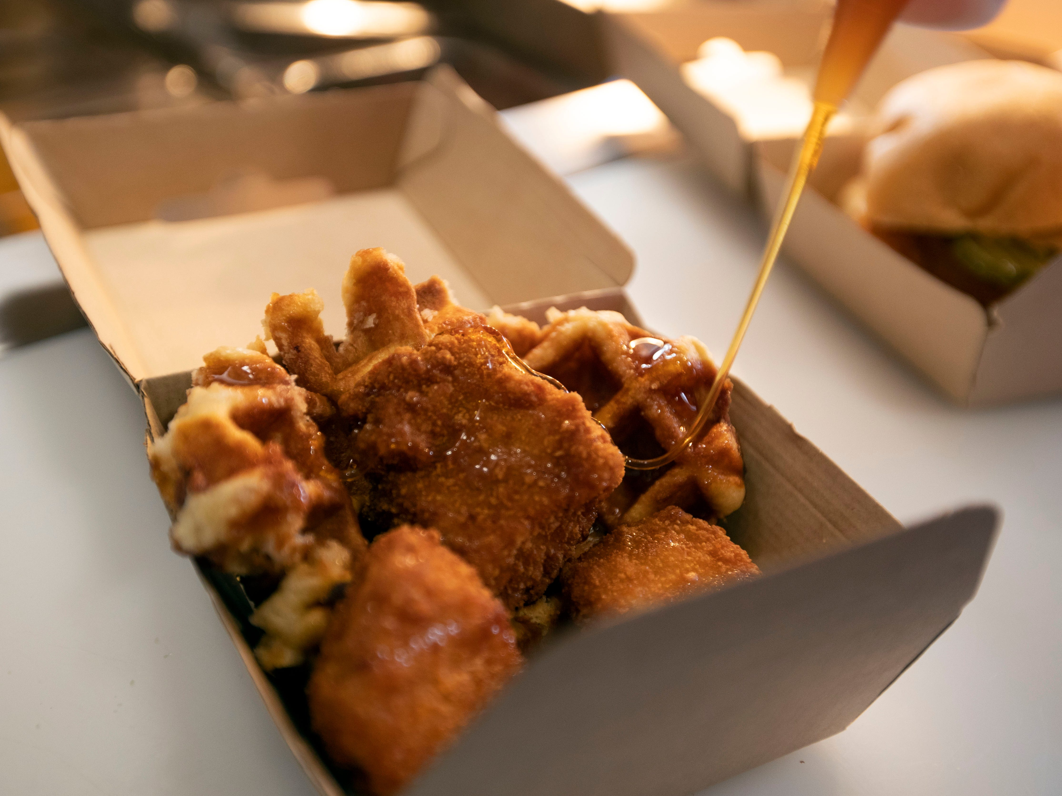 Rooster's Chicken Shack menu features chicken and waffles, a fried filet, waffle bun and maple syrup.